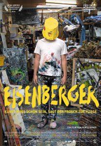 Eisenberger filmposter - Mann med malingsflekker på seg med bøtte over hode